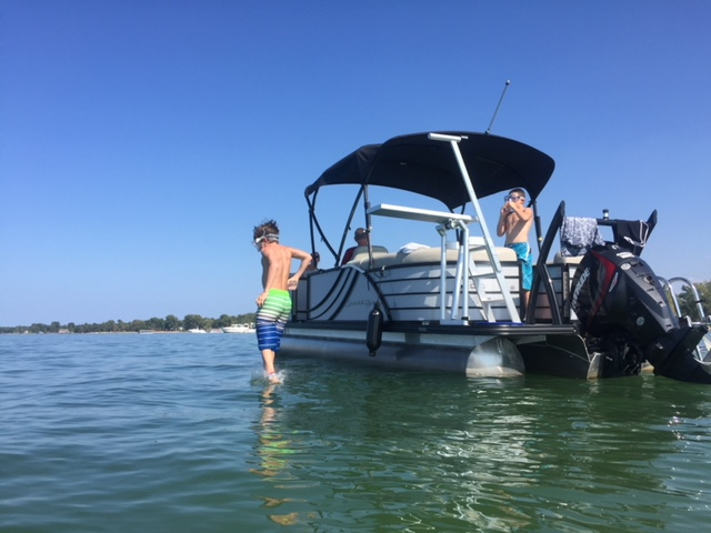Boy jumping in off diving board - Caseville Pontoon Boat Rental.JPG