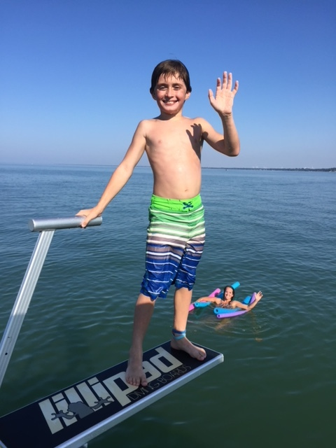 Little boy on diving board - Caseville Boat Rental.JPG