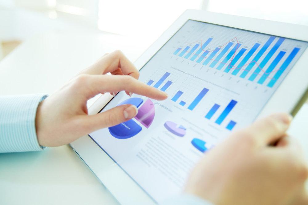 Woman-Analyzing-Metrics-on-Tablet-1024x682.jpg