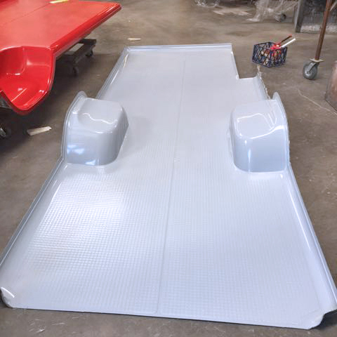 Floor panel coming out of the mold