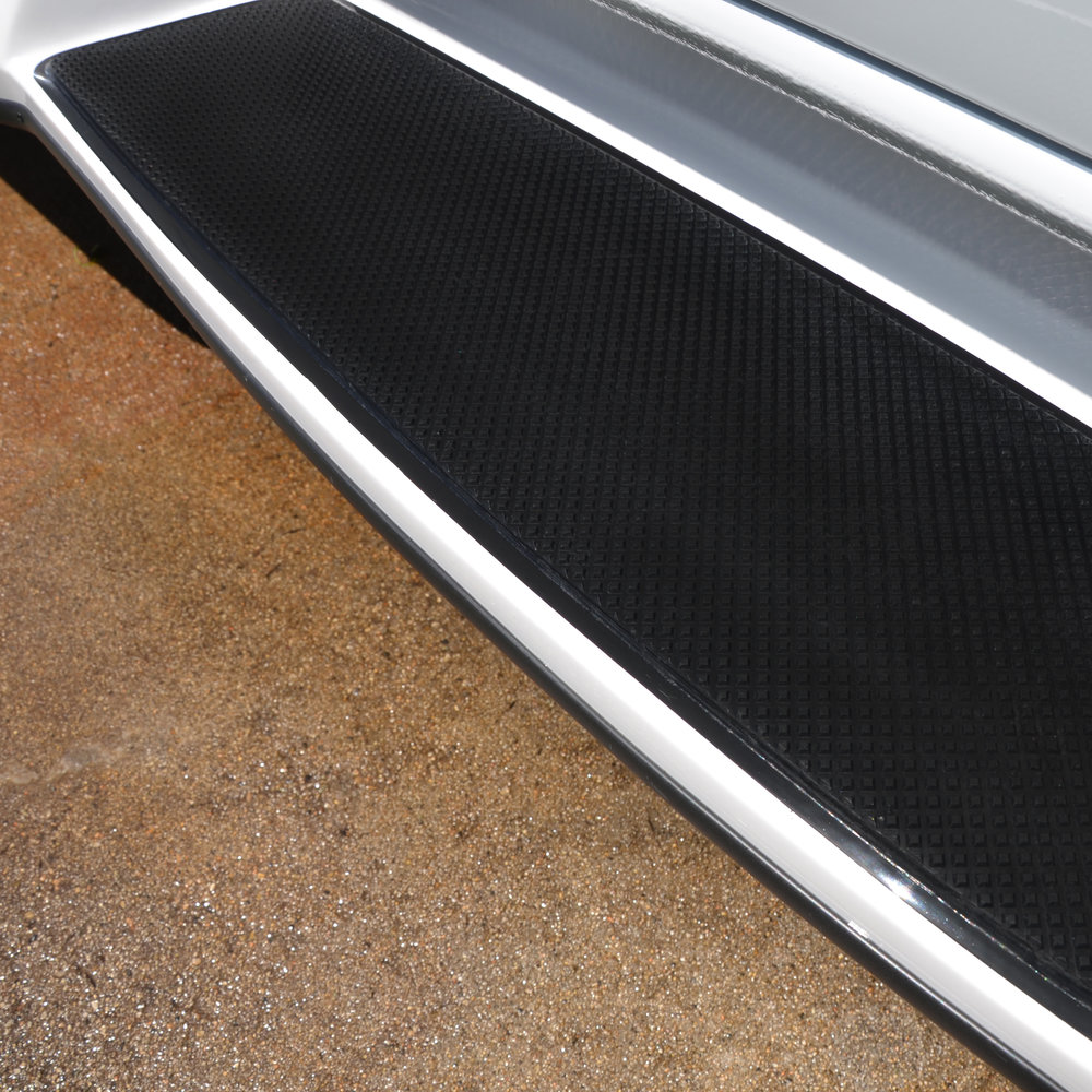 Close-up of integrated anti-skid pattern on step.