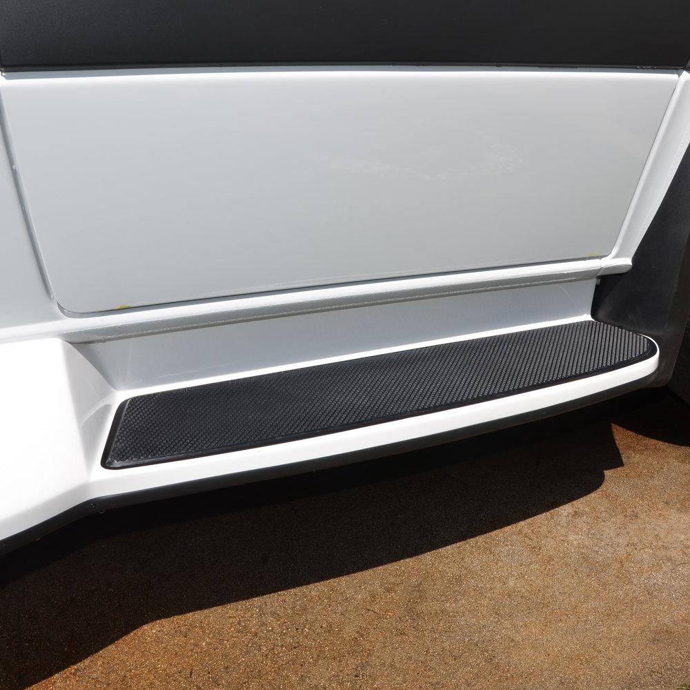 Close-up of front step on passenger side.