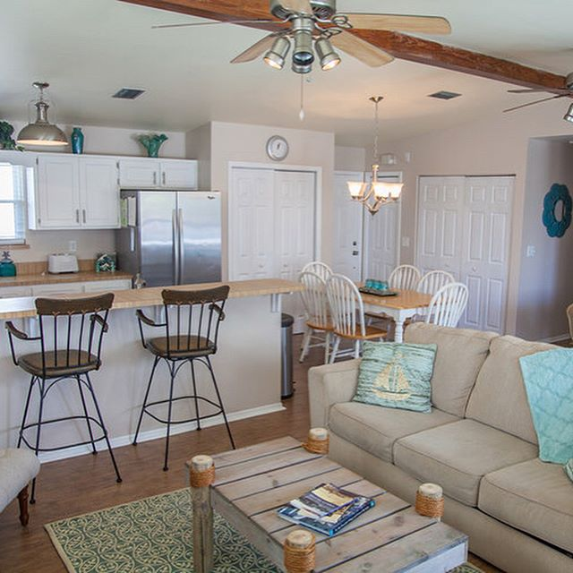Meet our upstairs beach unit, the Starfish! One of the things we love most about this one is the ocean view from the back porch. Swipe left to take a peek, although the photos really don't do it justice!