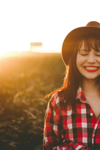 about-invoking-joy-smiling-woman-with-red-lipstick-3-e1496623181204.png