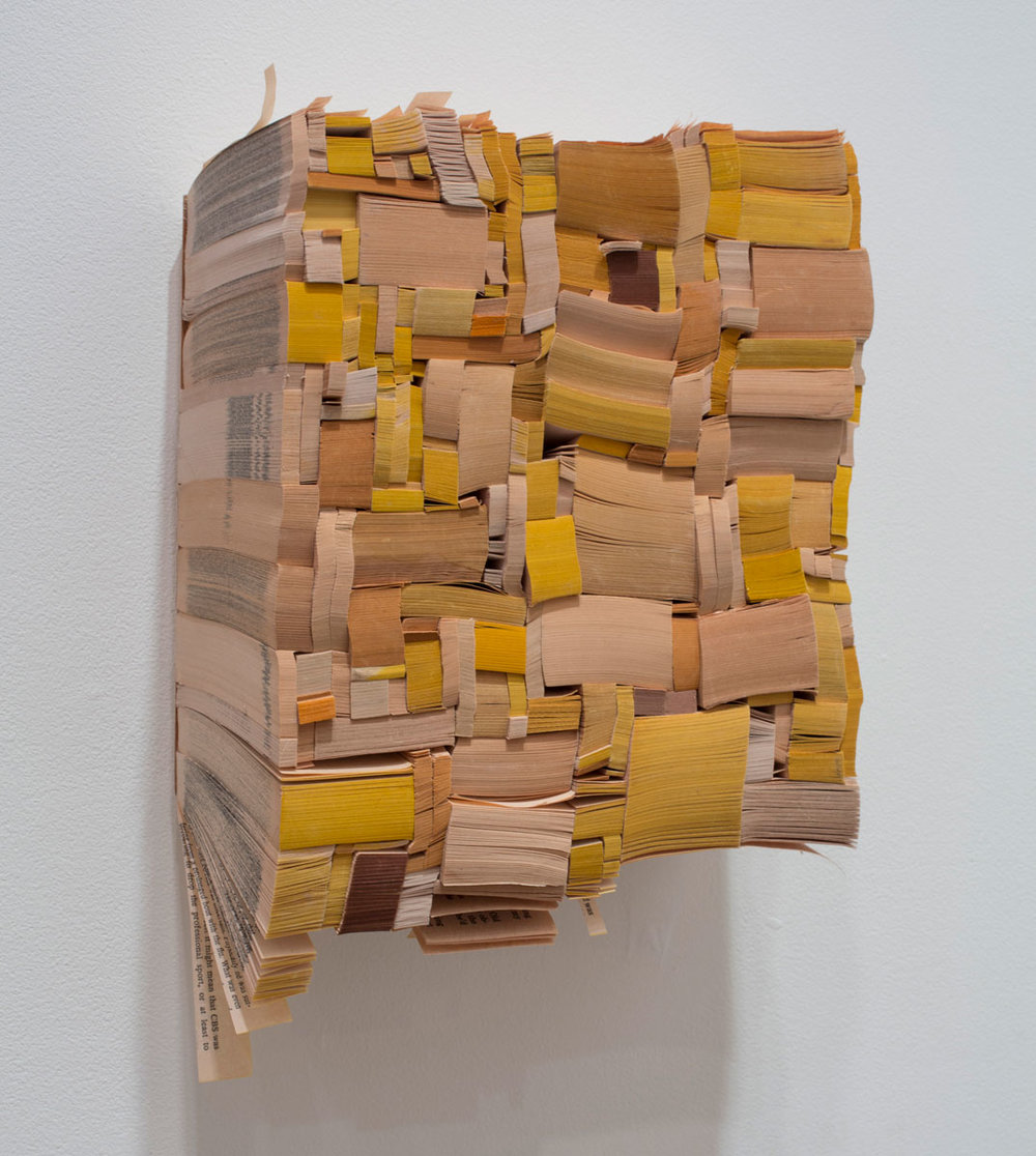 Word , 2013 paperback book slices, wood and bookbinder's glue 9.5 x 8.75 x 4""