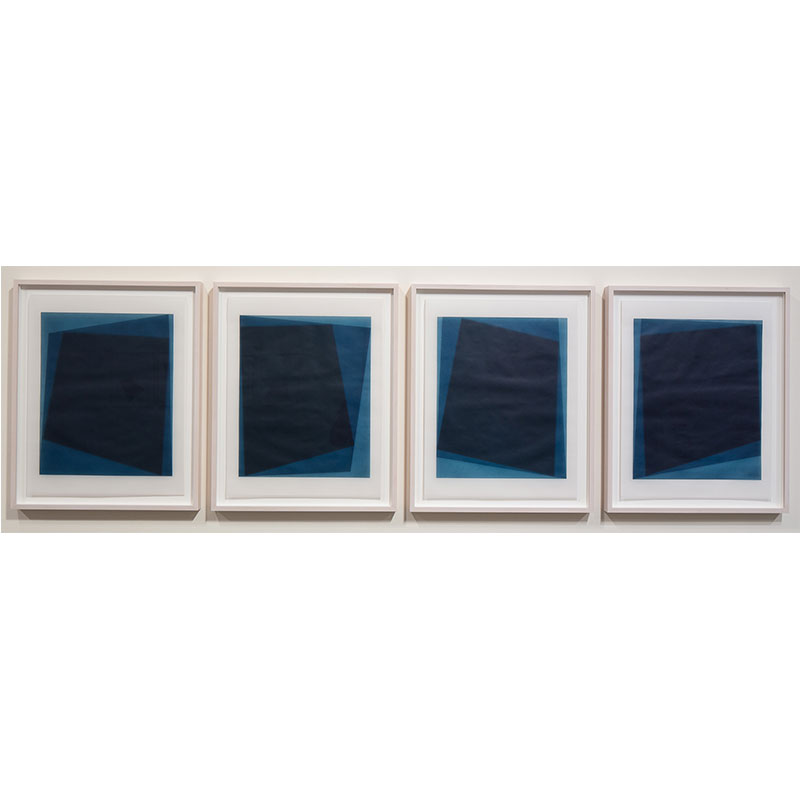 "Untitled, 2016-0117/0120 , 2016 suite of 4: indigo pigment in wax on paper 26.5 x 21.5"" framed each  Inquire >"
