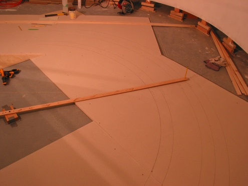 "My 60"" min. mainline radius was laid out using a trammel pinned to a block of wood, duct taped to the floor. Nothing could move out of alignment at this point. All track and cut lines were made now."