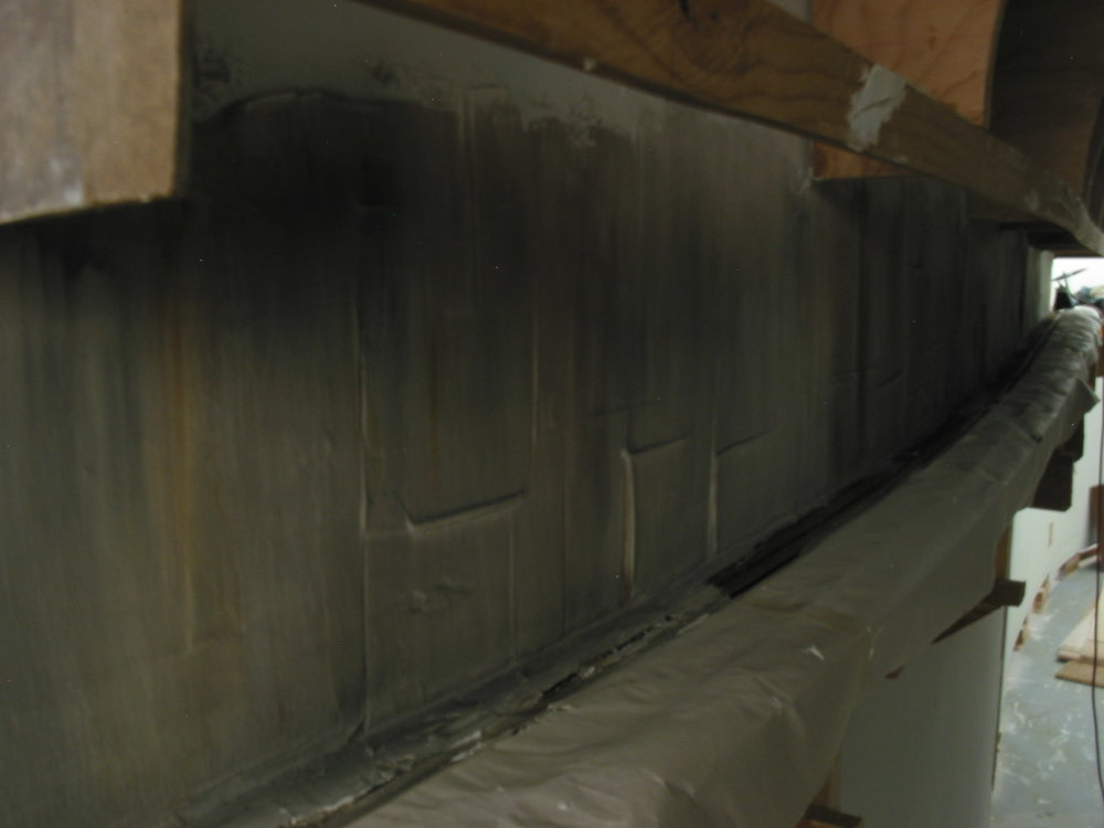 "I left ""mortar weep"" lines in the joint compound as it was applied to the drywall so as to replicate imperfect form joints in the construction of the tunnel's interior."