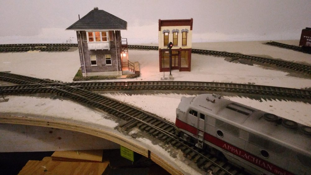 "Linnwood shares the new ""rain room"" with Ridge. Here the A&O crosses the C&O's Huntington to Charleston mainline. RJ Cabin is a C&O ""standard brick cabin.""   Two staged C&O trains come into Ridge per session."