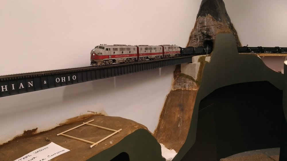 """Our train has exited MacDonald Tunnel and tip toes onto the """"steel thread"""". The stripwood rectangle identifies the location of one of the future support towers."""