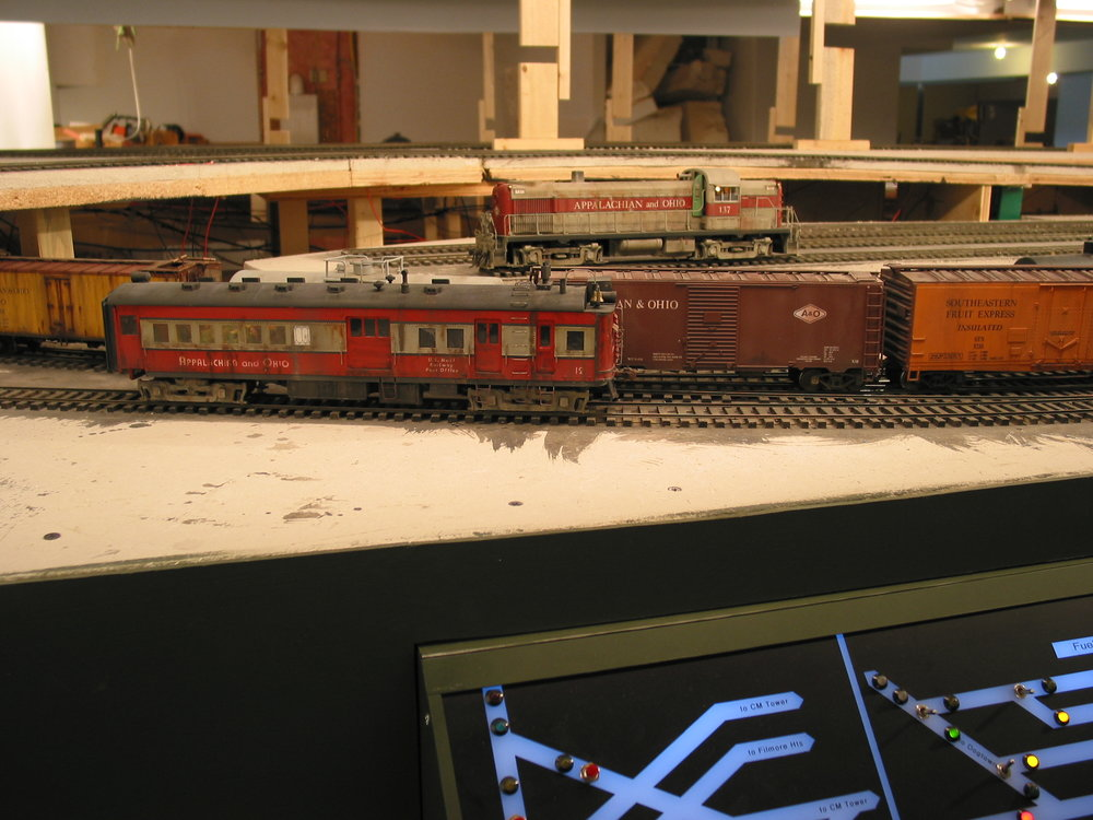 """At North Havens a train is coming up from the Dogtown staging while the doodlebug sits at the site of the future passenger platform along Havens Boulevard. The RS3 is """"in the engine house."""""""