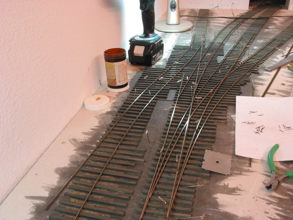Here I'm laying the rails into Whirlpool which are lengthend by piercing the wall into the stairway area. The completed throat turned out to be a 3-way and lap switch.