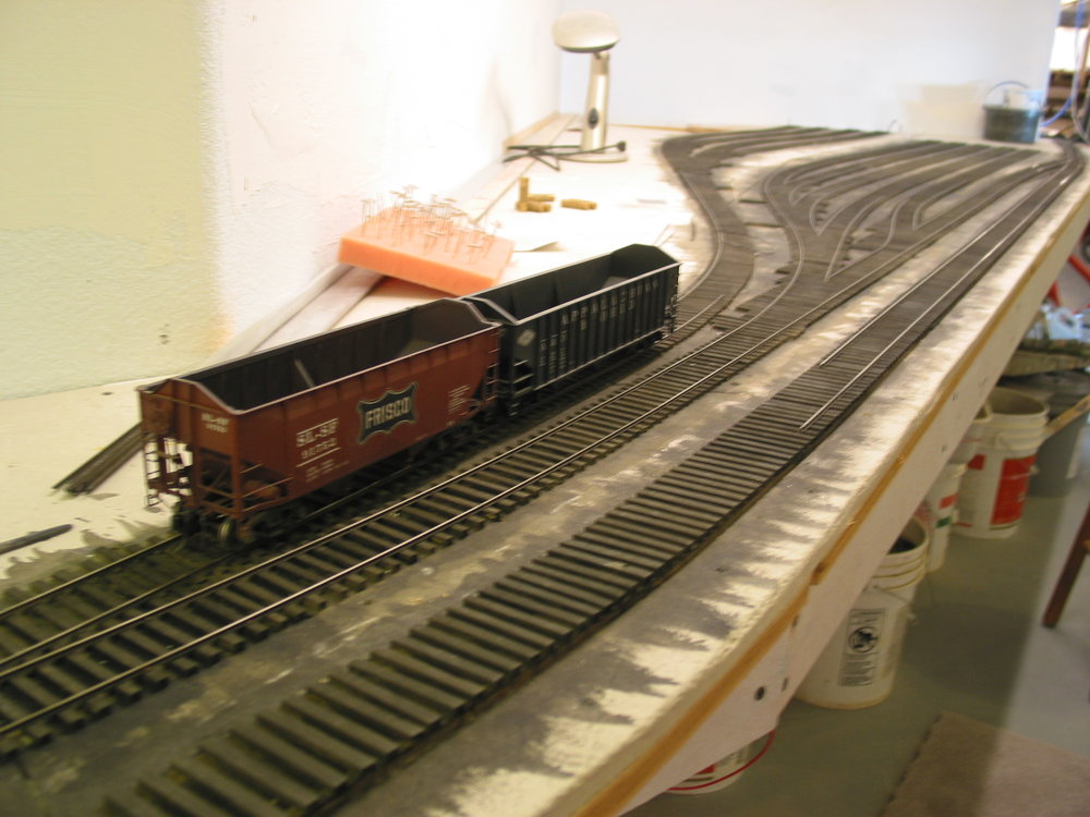 A pair of hoppers test early trackwork and provide inspiration for the project. Vince is a Frisco modeler.