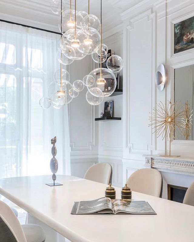 Currently obsessing over glass chandeliers - adding one to your space will always give an elevated look!  Photo via Pinterest