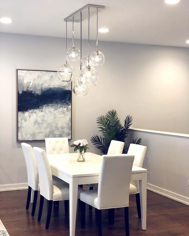 Finishing up this contemporary dining/living room in West Town. This gorgeous chandelier from @westelm really elevates the space!
