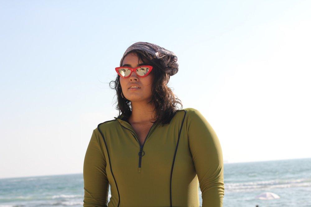 Hannah wears Scarf, Vela scarves ,  Sunglasses, TopTen ,