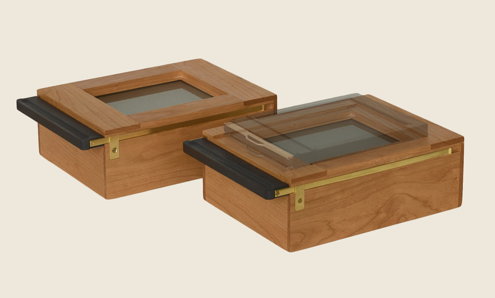 - Available in Teak or Cherry with Satin FinishThe Iodine Box can be ordered standard or with a custom top adapted for sensitizing under daylight conditions. This combined with a Century Darkroom Mercury apparatus enables one to make daguerreotypes anywhere without a darkroom.