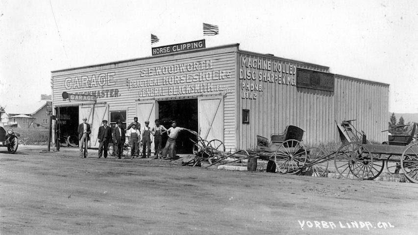 The Yorba Linda Garage and Blacksmith Shop on Main Street, circa 1920; built by and co-owned by Eldo West (courtesy the Orange County Archives).