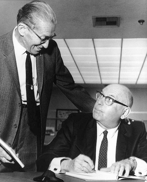 Leo Friis (right) autographing one of his many local history books, circa 1968 (courtesy the Anaheim Public Library).