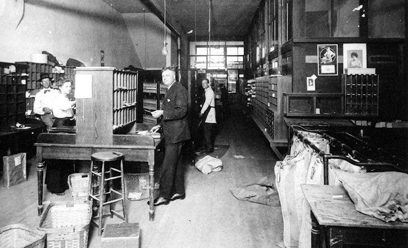 Postmaster Nelson Edwards (center), inside the Orange Post Office on East Chapman Avenue, ca 1912.