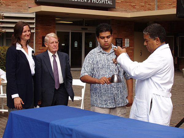 As Maggie and Reg Green look on, a UCLA heart transplant patient commemorated the decade since Nicholas Green's donation of organs by ringing a bell ten times.