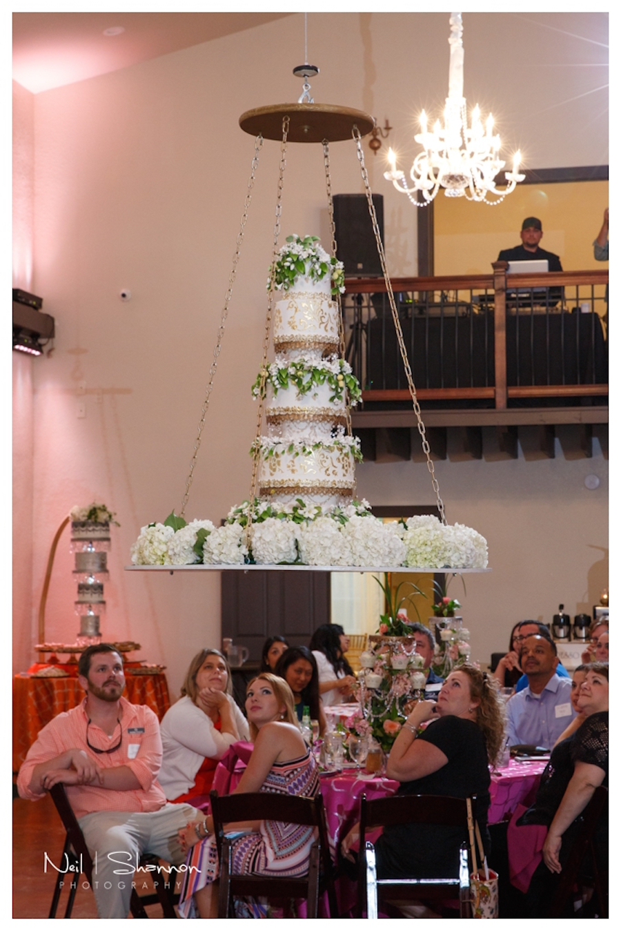 7-Tier White and Gold Round Hanging Suspended Wedding Cake with Greenery | Sarasota Wedding Cake and Dessert Baker The Cake Zone