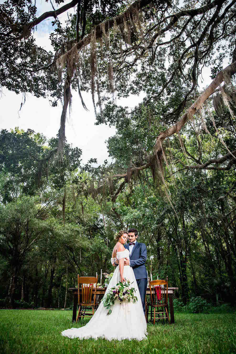 Bride wearing Amsale wedding dress from Blush Bridal Sarasota and Groom Portrait | Southern Inspired Outdoor Wedding Reception Decor Styled Shoot at Tampa Bay Wedding Venue Bakers Ranch