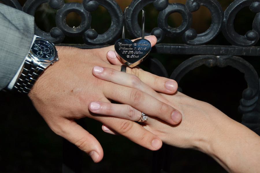 Bride and Groom Key Lock Wedding Portrait at Lovers Lock Bridge at Sarasota Wedding Venue Bakers Ranch