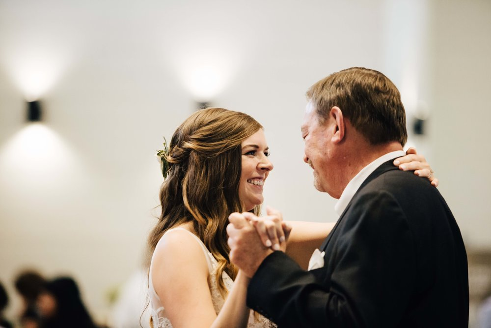 Bride smiling during Father Daughter Dance at her wedding reception at Chestnut Ridge in Asheville, North Carolina, Music played by Benjamin T Warner DJ & Musician, Photography by Amanda Sutton Photography