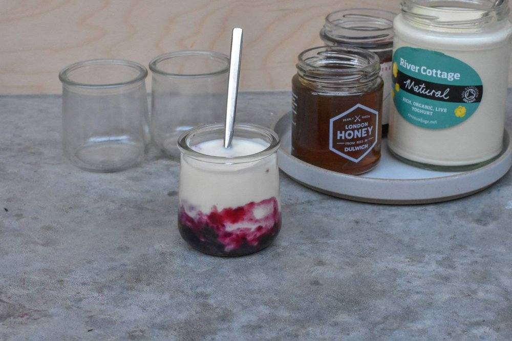 yogurt - Like the rest of the dairy things, plastic-free yogurt isn't easy to find - especially in supermarkets.In bigger stores, you might get lucky and find Liberté yogurts in glass pots. The pots are keepers (see pic). We've got a stash that we use for chocolate mouses, fancy granola parfait things, and I even knocked up a few homemade candles in them at Christmas.Or, you can hunt down River Cottage yogurts. We get ours delivered by Milk & More, which couldn't be easier.Finally, a lot of people (not just hippies) swear by homemade yogurt. I'm tempted to get one of these makers and give it a go myself.