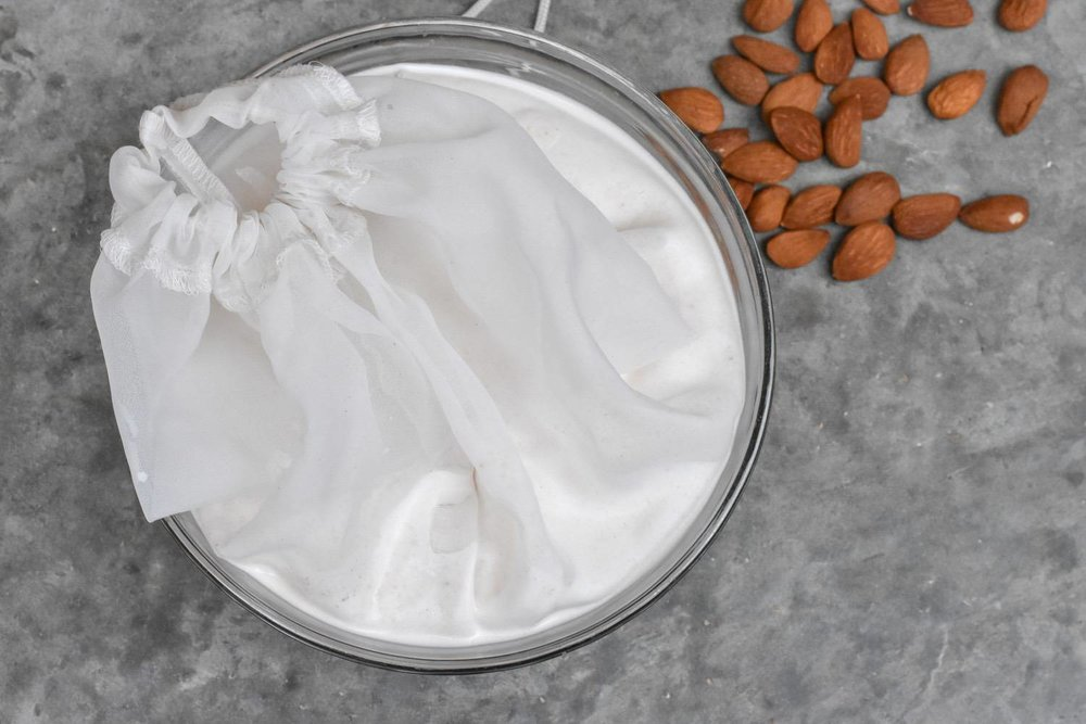 homemade NUT mylks - I really really want you to try this!If you have a Nutri-bullet, or other powerful-ish blender, it's a total doddle.Soak the nuts overnight. Rinse. Blend with fresh water, a pinch of sea-salt and a date (optional). Strain through a muslin cloth, nut-bag or old tee-shirt. For small amounts, use a coffee plunger. Bosh! It's nuts (sorry) how easy it is. To avoid waste, se the leftover nut pulp in all kinds of recipes.I've found oat milk is trickier - it needs to be strained through something more closed-weave than muslin, and it has a tendency to go a bit gluey. I've tried countless times and it's always slimy. If anyone knows what I'm doing wrong, I'd love to know?