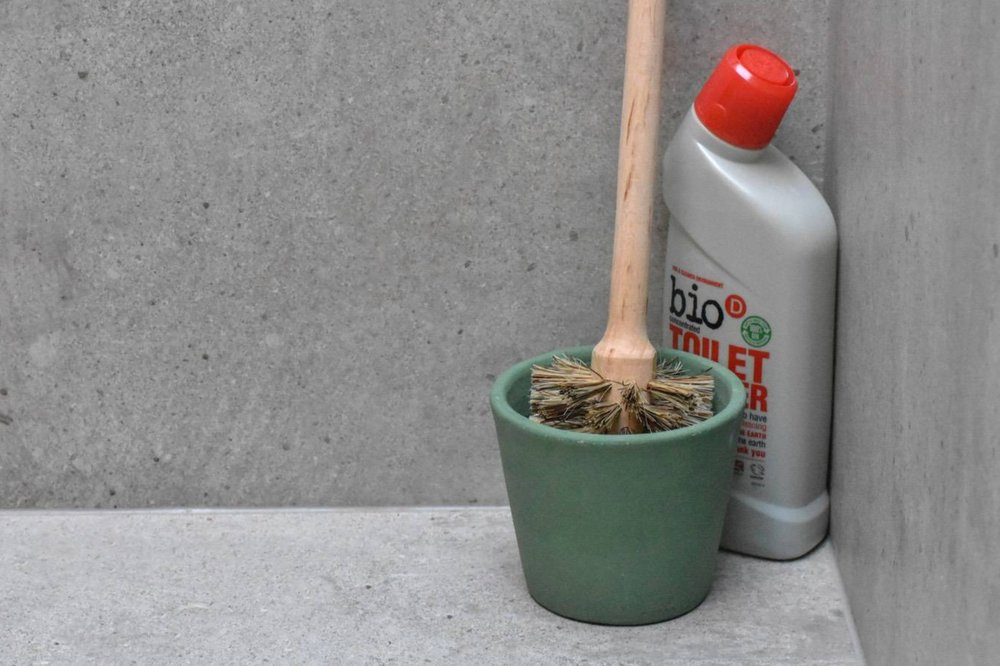 TOILET CLEANING - Oh hey, here's my toilet brush. Nothing weird about that, right?Toilet cleaner is another product that we now buy in five-litre 'bulks', and top up. I'm a big fan of Bio D. The packaging is 100% recycled plastic and the products themselves contain no ingredients that are going to cause problems for aquatic life.And the loo brush - its wooden with plant-based bristles, making it 100% compostable. Seen here with a random plant pot, but I think the terracotta pots with a draining hole and saucer would probably be better).