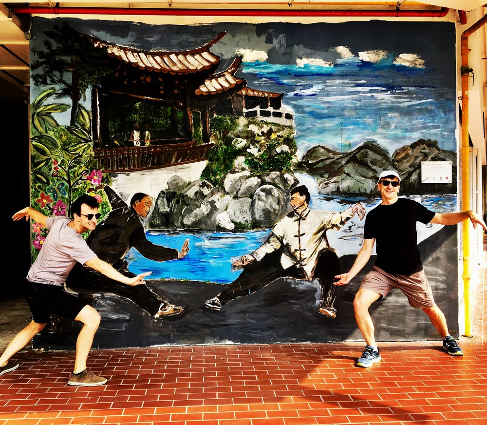 The brothers trying to emulate the poses and do the tai-chi with these men. My French professor Pierre Duffie and his brother who was visiting and I must say they did quite well...this wall is directly facing the junction where Keong Saik Road is.