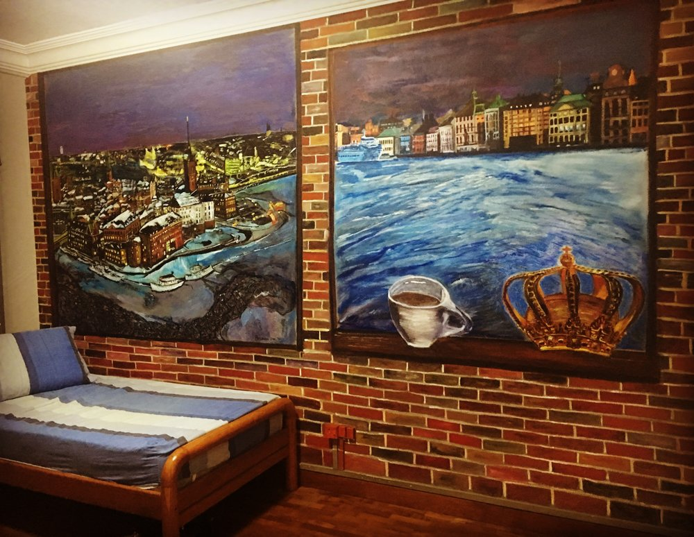 Year: 2014 2 weekends.  Valkommen till Stockholm! This was done in my son's bedroom. To complete the wall, I painted another image on the right. I envisioned myself sitting in a bedroom in a ship that the Scandinavians are famed for, sipping a big cup of coffee looking out at sea and the buildings along the coast and shoreline. It brings back memories of my stay there and also for my son who worked there as part of student exchange program. This wall became a talking point each new year when his friends come to visit. The bricks were also added giving it a kind of grunge look and feel to a room in the cafe.