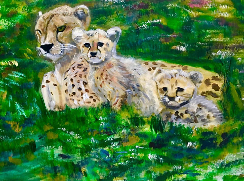 My other favourite image was the cheetah and her cubs. Although they are predators, I wanted to portray the cheetah family equivalent to that of the human family in that the mother is ever protective of her young ones.