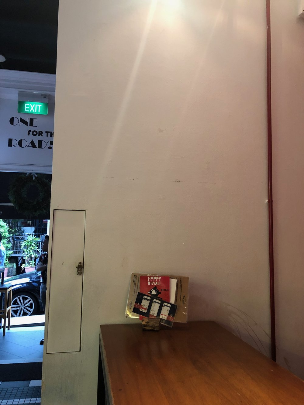 How the blank wall looked like prior to being painted and the light compartment on the left!