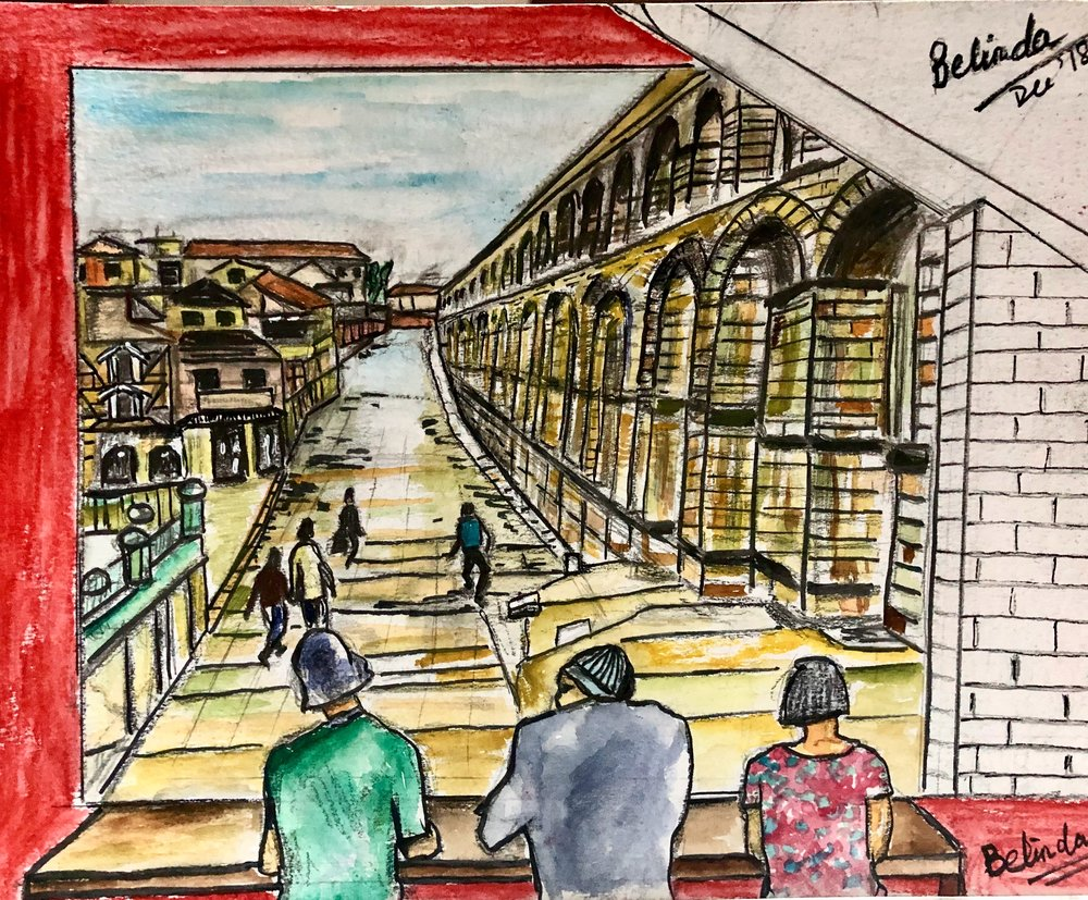 The fourth sketch of the larger wall after the wall where the cat is. It's showing people looking out as if it's a window from a cafe. The people are in there to give the impression of looking out from the inside and they represent the customers who will be sitting around there too. This wall shows Segovia which is a UNESCO heritage located in Spain. As the owner is a avid traveller, he liked this place so much that he wanted to bring it over here to this wall.