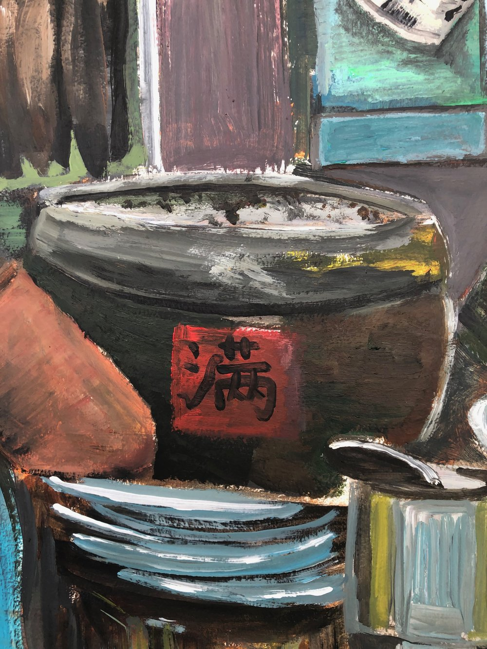 The Chinese character pronounced 'mun' means full and is symbolic meaning that whatever it contains - may it always be full. This word is usually pasted onto urns used for storing staple food like rice.