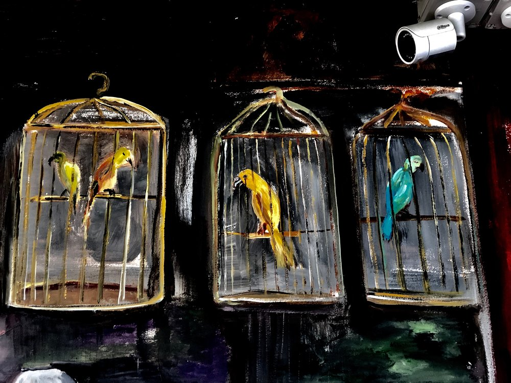 Those days, birds hung in cages to be admired and where people can hear them sing. I was a bit hesitant to add these as I felt birds should be freed but after second thoughts, since it's a heritage wall, i changed my mind..