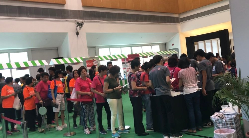 Participants queuing up to get their stamps in order to get freebies during the Event.