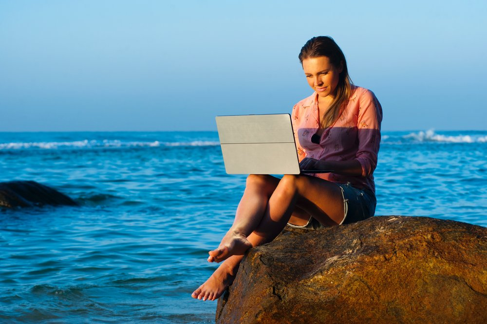 Really realistic photo of girl working on her laptop