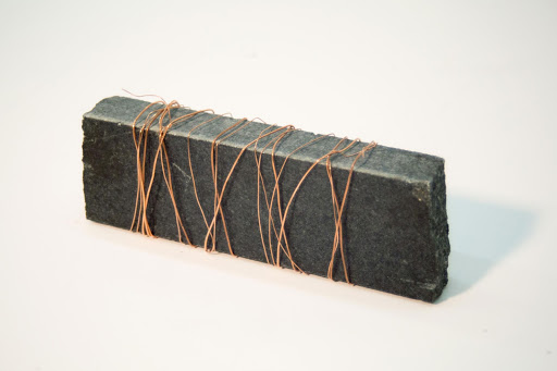 "Wrapped Up , Black granite and copper wire, 6 x 2 x 1"", 2015"