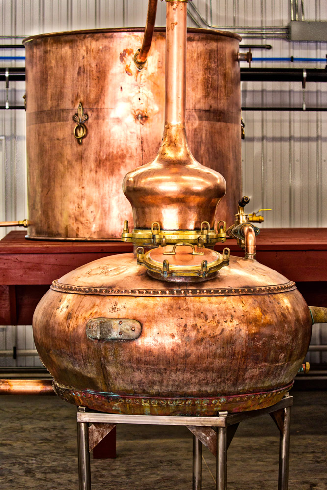 Tradition. - We make bourbon in a pot still.  That's the way all bourbon was made before 1850, and the way cognac and scotch is made in Europe.  Nowadays, the major American distilleries have abandoned the traditional pot still for continuous column distillation.