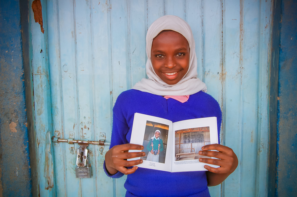 IMPACT REPORT - When Aisha received her book of curated images, she had a smile from ear to ear. She was able to share her book with her classmates and spent hours looking at the images over and over. To give girls a sense of pride and self worth is an irreplaceable honor. Special thanks to Chatbooks who provided these beautiful keepsakes!