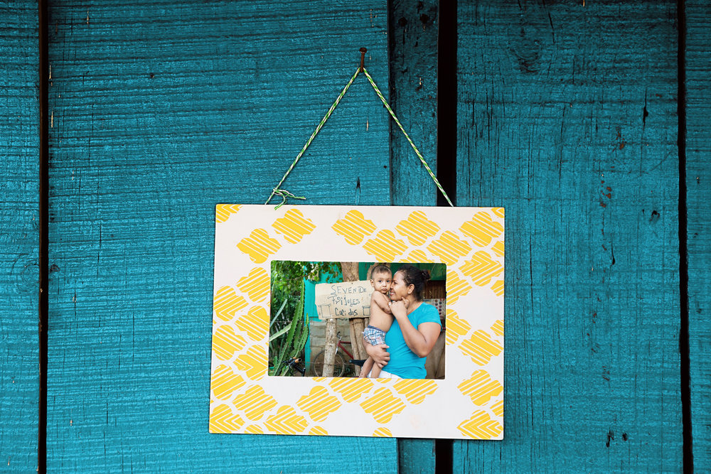 ACTION - We print and distribute photos on location in colorful, lightweight frames.  These same frames are available to you for your own memories! You can support our projects with a frame purchase.
