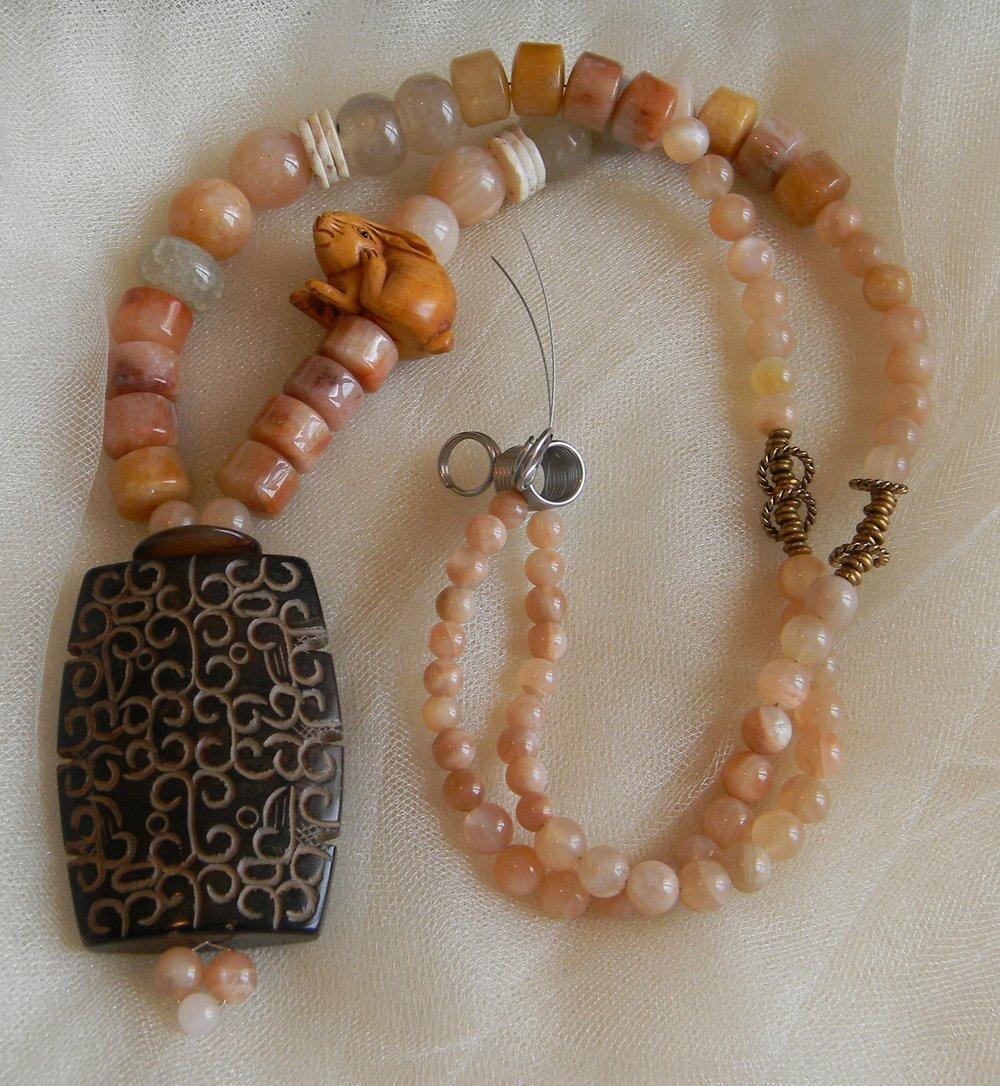 Large jade pendant with sun stone necklace