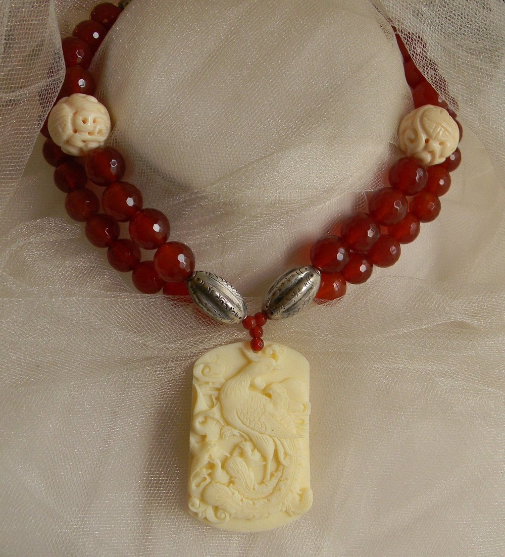 Phoenix bone pendant with vintage silver and carnelian necklace