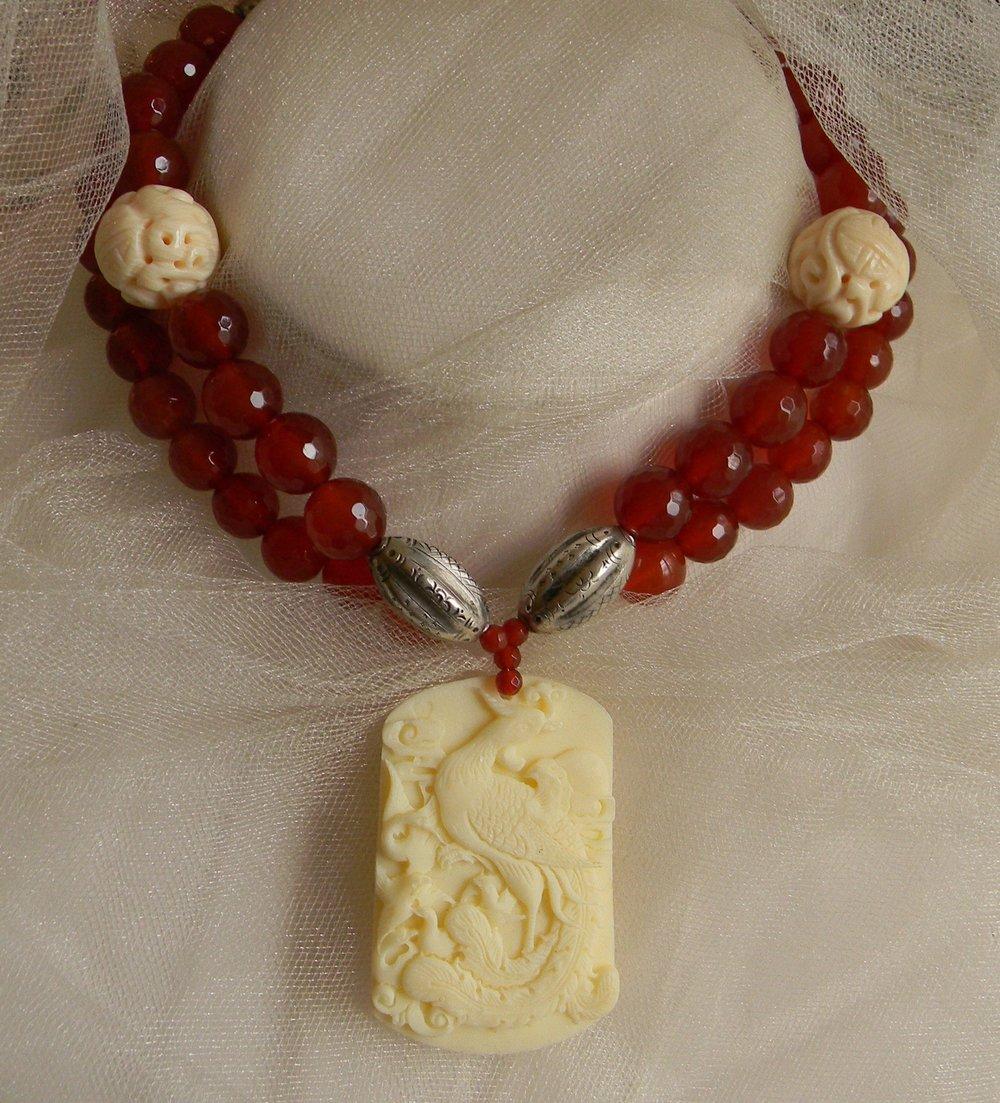 Phoenix bone pendant with vintage silver and carnelian necklace