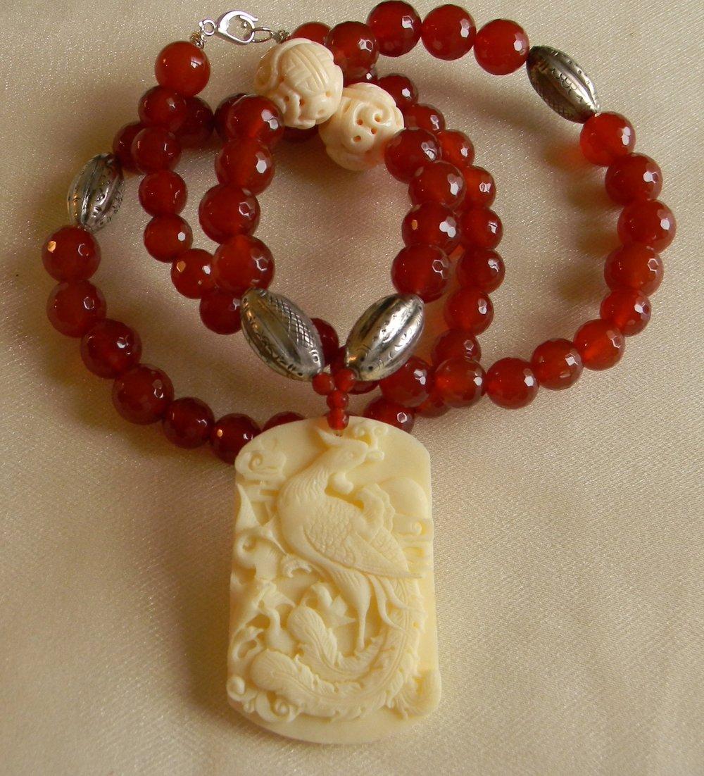 Pheonix bone pendant with carnelian beads necklace
