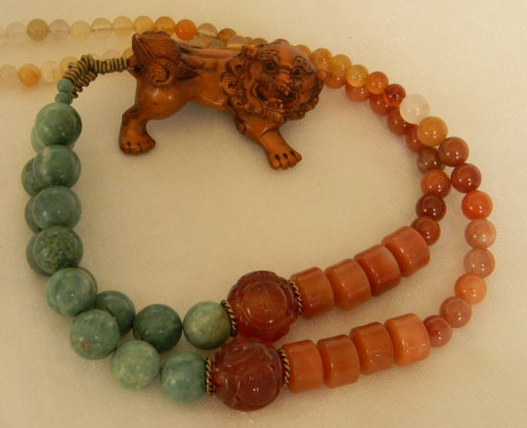 Netsuke Fu Dog with jade & carnelian necklace